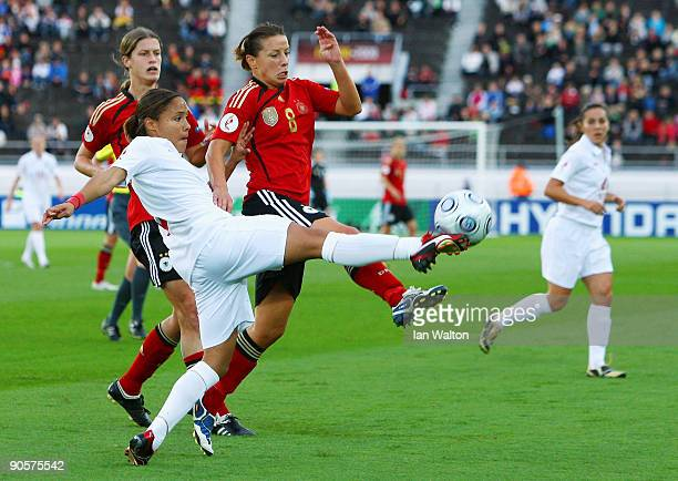 Inka Grings of Germany attempts to tackle Alex Scott of England during the UEFA Women's Euro 2009 Final match between England and Germany at the...