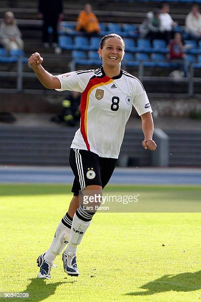 Inka Grings of Germany celebrates after scoring the second goal during the UEFA Women's Euro 2009 quarter final match between Germany and Italy at...