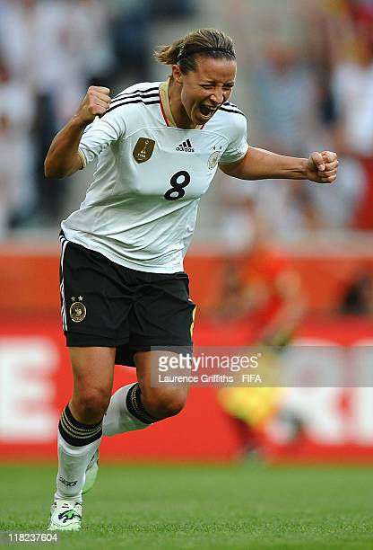 Inka Grings of Germany celebrates scoring the scecond goal during the FIFA Women's World Cup 2011 Group A match between France and Germany at...