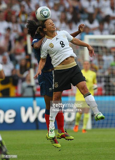 Inka Grings of Germany heads the ball during the FIFA Women's World Cup 2011 Group A match between France and Germany at Borussia Park on on July 5,...