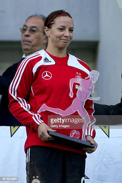 Inka Grings of Germany poses with the second price after the Women Algarve Cup final match between Germany and USA on March 3 2010 in Faro Portugal