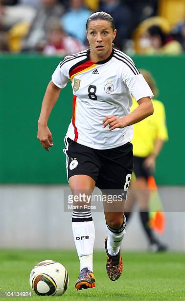 Inka Grings of Germany runs with the ball during the Women's International Friendly match between Germnay and Canada at Rudolf Harbig stadium on...