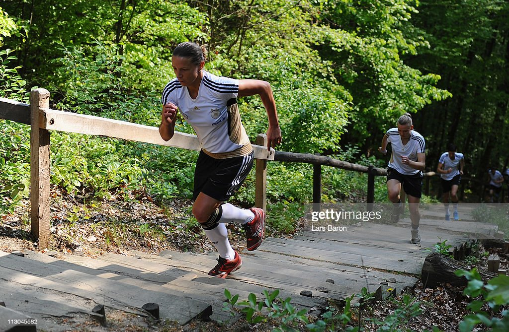 Inka Grings runs up the 'Glessen stairs' infront of Alexandra Popp during a German Women National Team training session at Villaforstpark on April 23, 2011 in Brauweiler, Germany.
