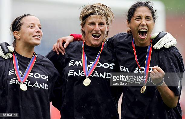 Inka Grings Silke Rottenberg and Steffi Jones celebrate after the UEFA Womens Euro 2005 Final between Germany and Norway on June 19 2005 in Blackburn...