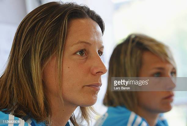 Inka Grinks looks on next to team mate Lena Goessling during a German Women National Team press conference at NetCologne Stadium on April 20 2011 in...
