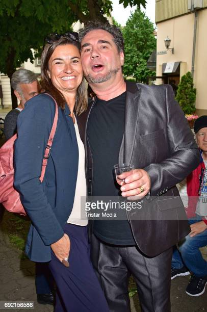 Inka Schneider and Marco Mannozzi attend the Marco Mannozzi store and makeup studio opening at Nikolaiviertel on June 3 2017 in Berlin Germany