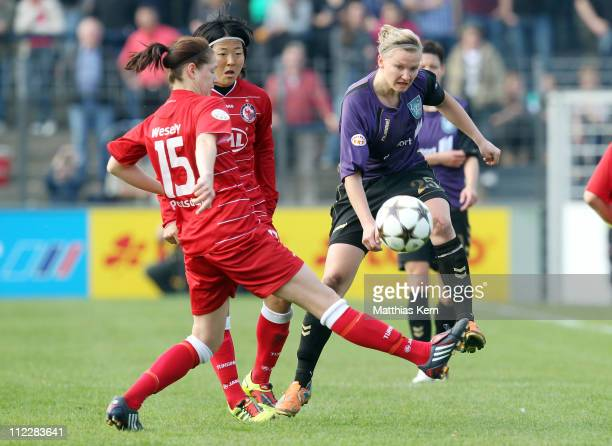 Inka Wesely Yuki Nagasato and Alexandra Popp battle for the ball during the UEFA Women's Champions League semifinal second leg match between Turbine...