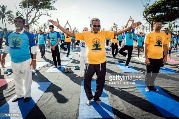 Inkatha Freedom Party founder and South African opposition leader Mnagosuthu Buthelezi take part in a yoga session at North Beach on June 17 2018 in...