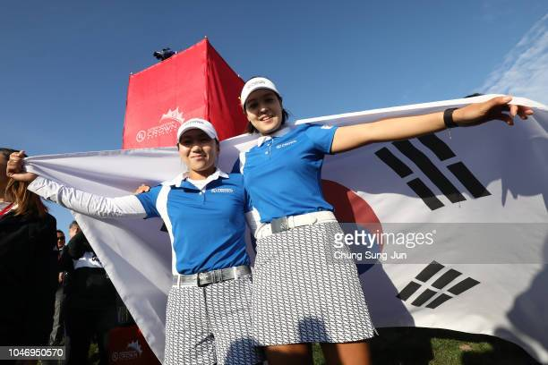 In-Kyung Kim and In Gee Chun of South Korea celebrate winning on day four of the UL International Crown at Jack Nicklaus Golf Club on October 7, 2018...