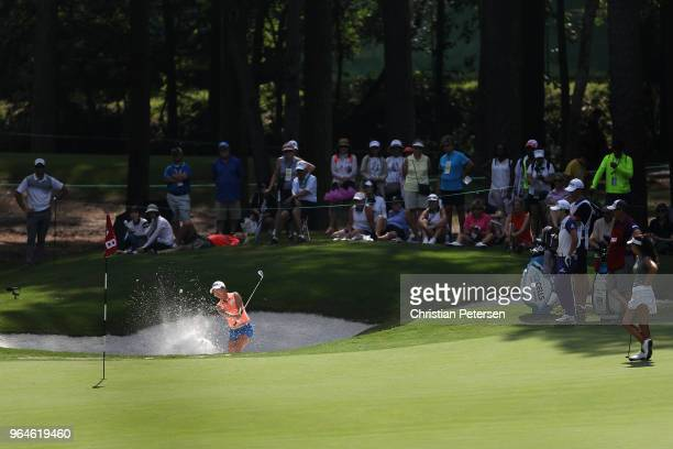 InKyung Kim of South Korea plays from the bunker onto the eighth green during the first round of the 2018 US Women's Open at Shoal Creek on May 31...