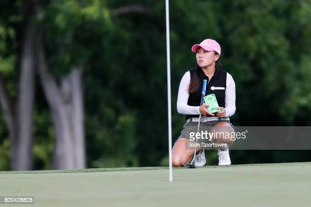 InKyung Kim of South Korea refers to her yardage book while lining up her put the 18th green during the first round of the LPGA Marathon Classic...