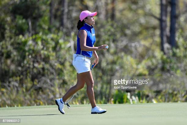InKyung Kim of South Korea sinks her putt on the eighth hole during the third round of the LPGA CME Group Championship at Tiburon Golf Club on...