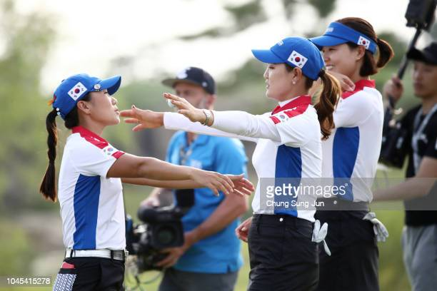 In-Kyung Kim, So Yeon Ryu and In Gee Chun of South Korea celebrate on the 18th green after the Pool A match between South Korea and Chinese Taipei on...