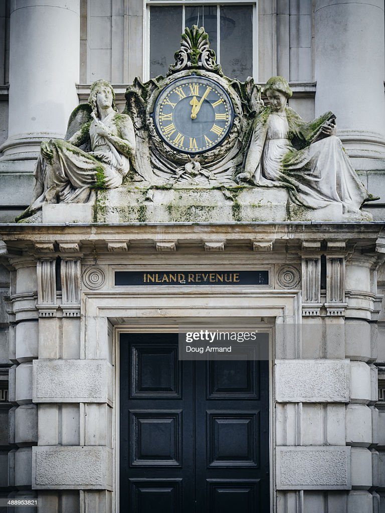 Inland Revenue sign and old clock : Stock Photo