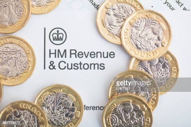 uk inland revenue tax form - britain stock pictures, royalty-free photos & images