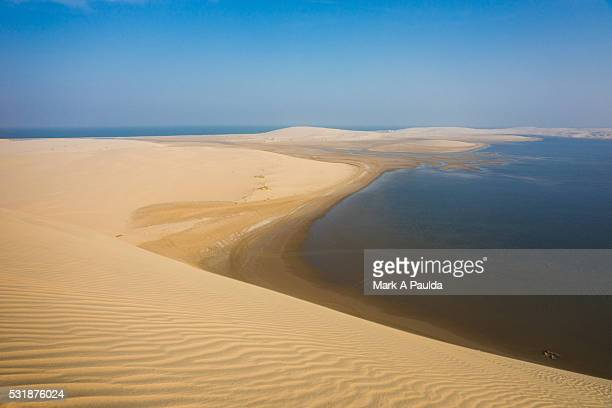 inland sea and sand dunes - qatar stock pictures, royalty-free photos & images