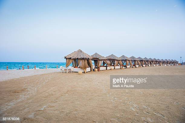 inland sea and sand dunes - qatar desert stock photos and pictures