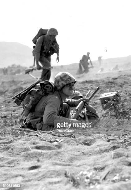 Inland shot taken at 0900 DDay plus 1 Iwo Jima February 20 1945 Marine in foxhole