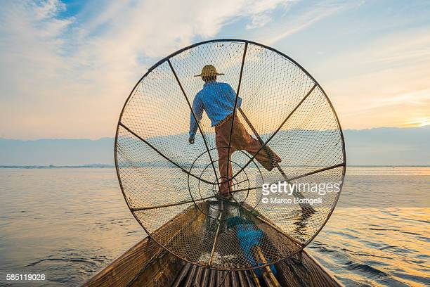 Inle lake, Nyaungshwe township, Taunggyi district, Myanmar (Burma). Local fisherman with typical conic fishing net.
