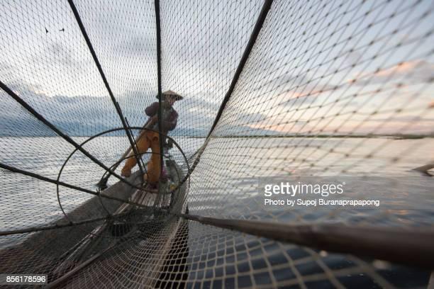 Inle Leg-rowing fishermen with traditional fishing at Inle Lake, Myanmar