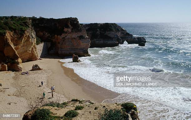 Inlet at the foot of a cliff along the Atlantic coast at Praia da Rocha beach Algarve Portugal