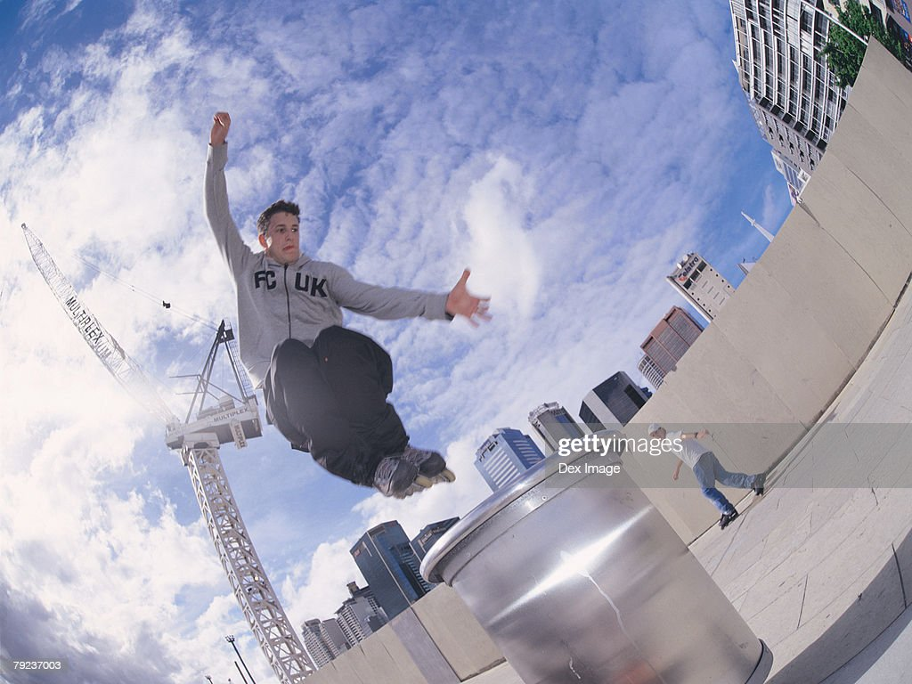 In-line skater in mid-jump : Stock Photo
