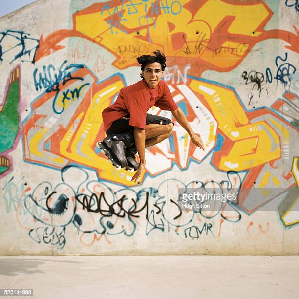 inline skater jumping - hugh sitton stock pictures, royalty-free photos & images