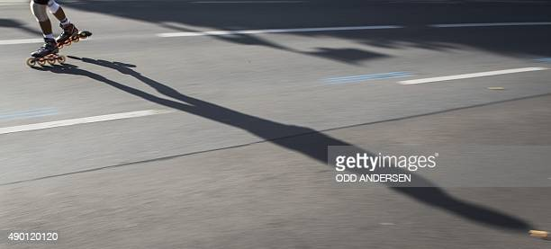 Inline skaters competing in the Berlin marathon power down Martin Luther Strasse in the Schoeneberg neighbourhood in Berlin on September 26 2015 Some...