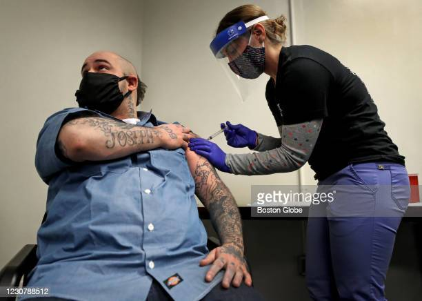 Inmate Christian Millett of Worcester gets the first of two COVID-19 coronavirus shots by Alyssa Dobbs, an LPN contractor in the medical department...