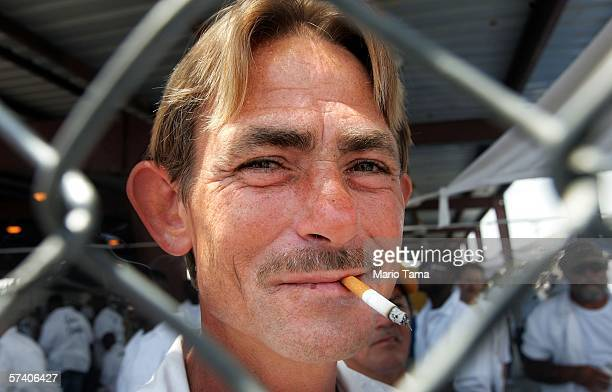 Inmate Danny Fabre smokes as he attends the Angola Prison Rodeo at the Louisiana State Penitentiary April 23 2006 in Angola Louisiana The Angola...