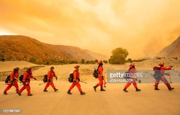 Inmate firefighters arrive at the scene of the Water fire, a new start about 20 miles from the Apple fire in Whitewater, California on August 2,...