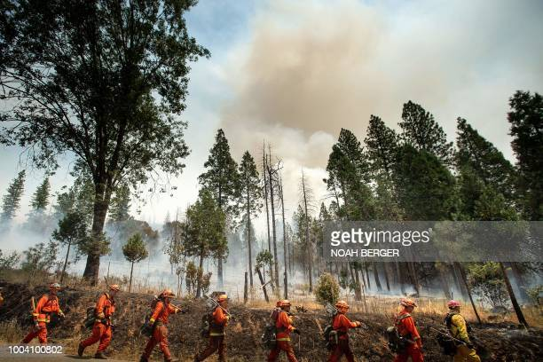 Inmate firefighters battle the Ferguson fire in Jerseydale California on July 22 2018 A fire that claimed the life of one firefighter and injured two...
