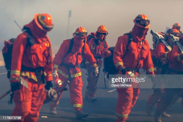Inmate firefighters from Oak Glen Conservation Camp near Yucaipa, California fight the Easy Fire on October 30, 2019 near Simi Valley, California....