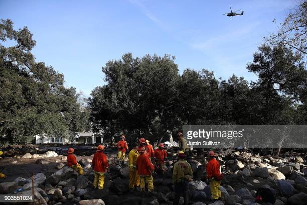 Inmate firefighters search for people trapped in mudslide debris on January 10 2018 in Montecito California 15 people have died and hundreds are...