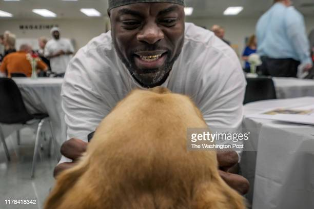 Inmate Herbert WilsonBey interacts with Kevin a service dog that he trained at Western Correctional Institution in Cumberland MD on October 24 2019