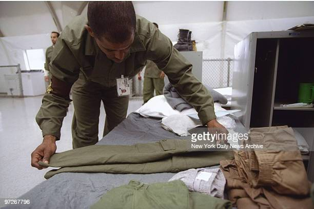 Inmate Lionel Jenkins folds his clothes with care at Rikers Island where he is in a High Impact Incarceration Program