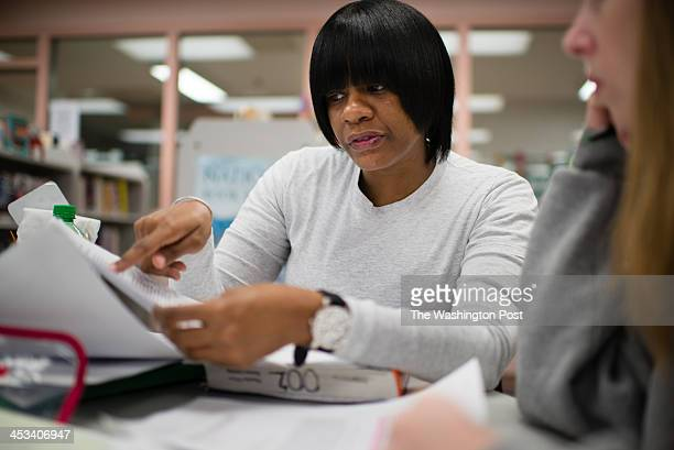Inmate Monnek Hall left is pictured talking to classmate Stephanie Spicer 30 Women at the Maryland Correctional Institution for Women in Jessup MD...