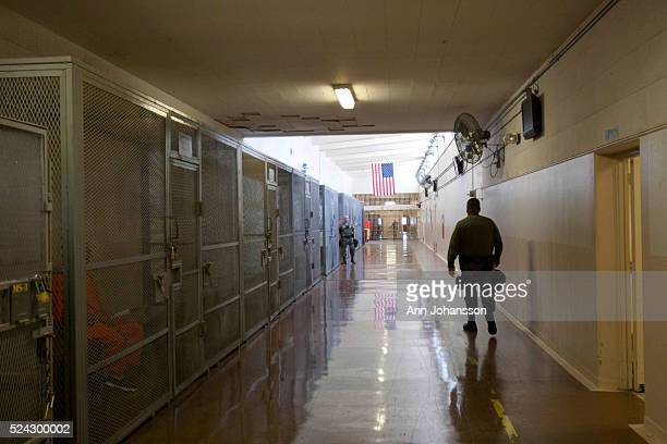 Inmates are held in cages as they wait for appointments along a hallway at California Institution for Men in Chino May 2011