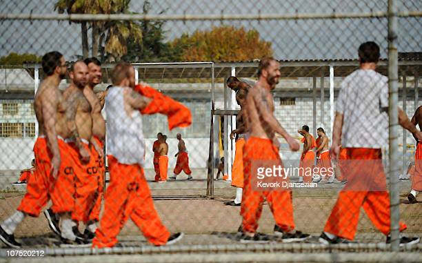 Inmates at Chino State Prison exercise in the yard December 10, 2010 in Chino, California. The U.S. Supreme Court is preparing to hear arguments to...