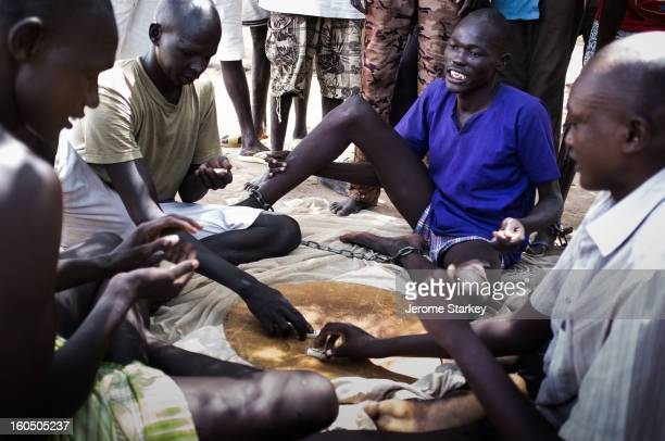 CONTENT] Inmates at Rumbek prison in South Sudan play dominoes to while away the days