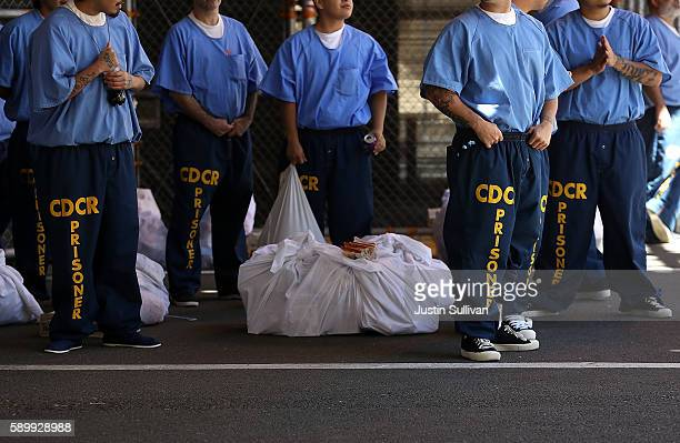 Inmates at San Quentin State Prison wait in line on August 15 2016 in San Quentin California San Quentin State Prison opened in 1852 and is...