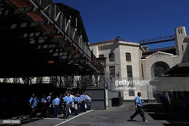Inmates at San Quentin State Prison wait in line to purchase items at the canteen on August 15 2016 in San Quentin California San Quentin State...