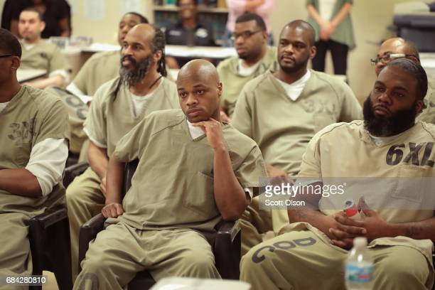 Inmates at the Cook County Jail watch as fellow inmates compete in a chess tournament online with inmates from the Prison Complex of Viana in...