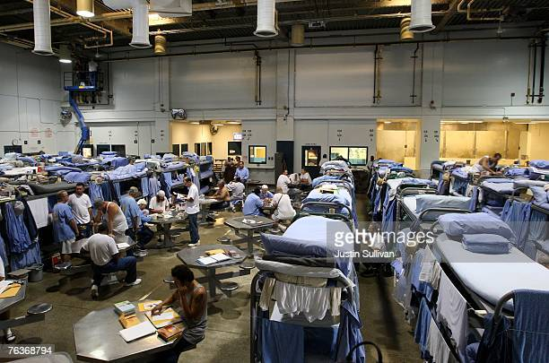 Inmates at the Mule Creek State Prison interact in a gymnasium that was modified to house prisoners August 28 2007 in Ione California A panel of...