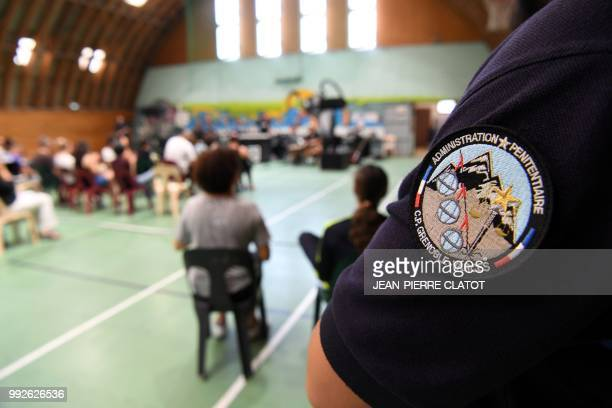 Inmates attend a Balani Sound System concert in the gymnasium of the GrenobleVarces penitentiary center on July 4 2018 in VarcesAllieresetRisset The...