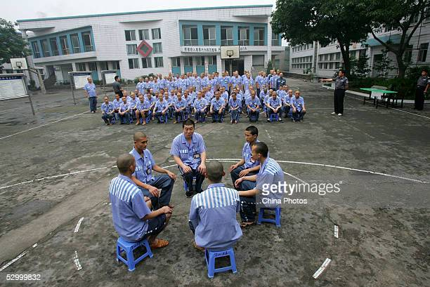 Inmates attend a behavior training session at Chongqing Prison on May 30 2005 in Chongqing Municipality China According to state media China has...