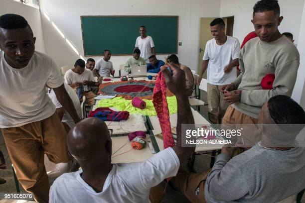 Inmates attend a crochet lesson as part of 'Ponto Firme' project in the Adriano Marrey maximum security penitentiary in Guarulhos Brazil on April 25...