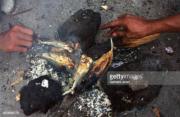 Inmates cook some fish, which they have to pay extra for as it is considered a luxury. Manila City Jail was built for 800 prisoners by the Spanish in...
