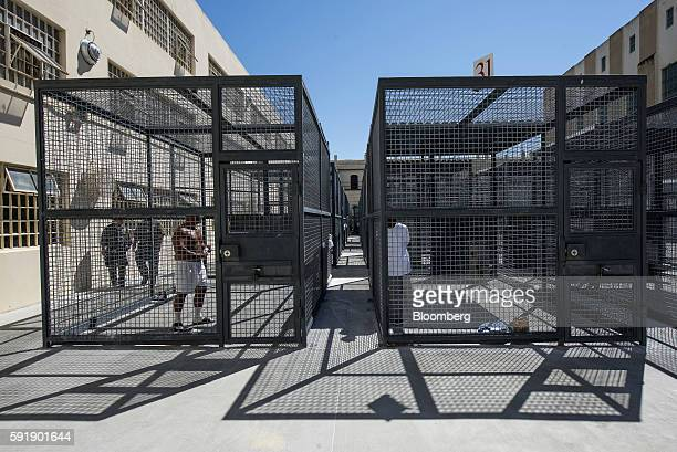 Inmates exercise in cages at San Quentin State Prison in San Quentin California US on Tuesday Aug 16 2016 San Quentin home to the state's only death...