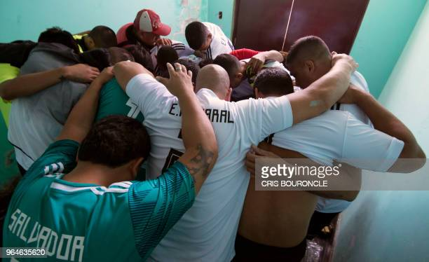 Inmates from a Peruvian jail cheer eachothers prior to their First Interprison World Cup Russia 2018 tournament football match at the prison in...